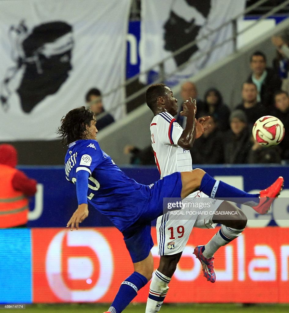 Bastia's French defender Francois Joseph Modesto (L) vies with Lyon's forward Mohamed Yattara during the French L1 football match Bastia (SCB) against Lyon (OL) on November 22, 2014 in the Armand Cesari stadium in Bastia, French Mediterranean island of Corsica.