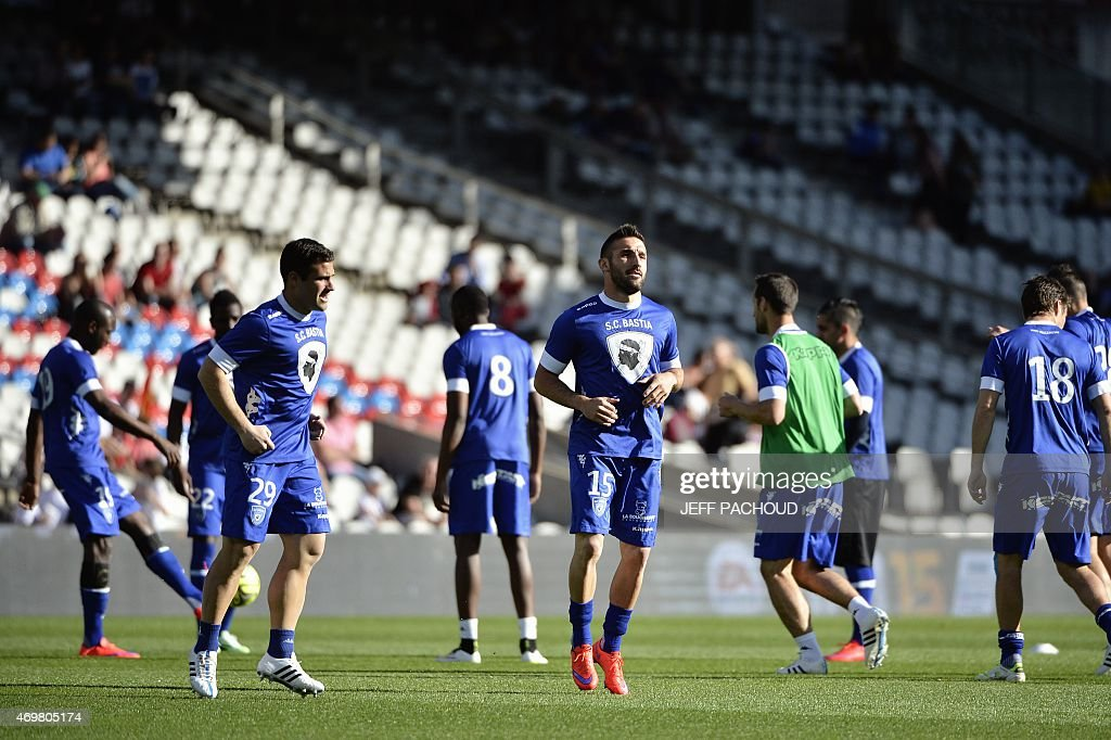 Bastia's French defender Julian Palmieri (C) and his teammates warm up prior to the French L1 football match Olympique Lyonnais (OL) vs SC Bastia (SCB) on April 15, 2015, at the Gerland Stadium in Lyon, central-eastern France.