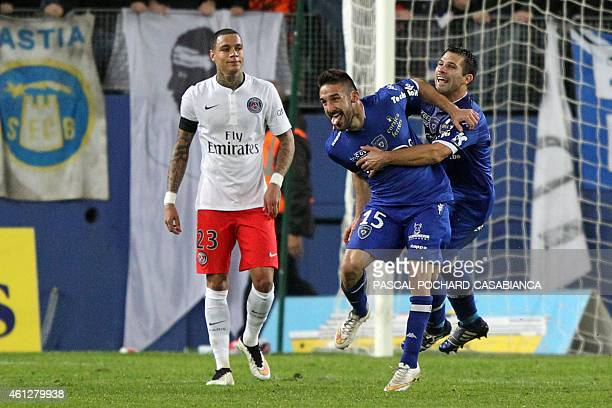 Bastia's French defender Julian Palmieri is congratulated by Bastia's French defender Gilles Cioni after scoring a goal as Paris SaintGermain's Dutch...