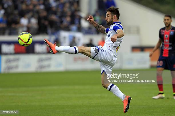 Bastia's French defender Julian Palmieri kicks the ball during the French L1 football match Gazelec Ajaccio against Bastia on April 24 at the Ange...