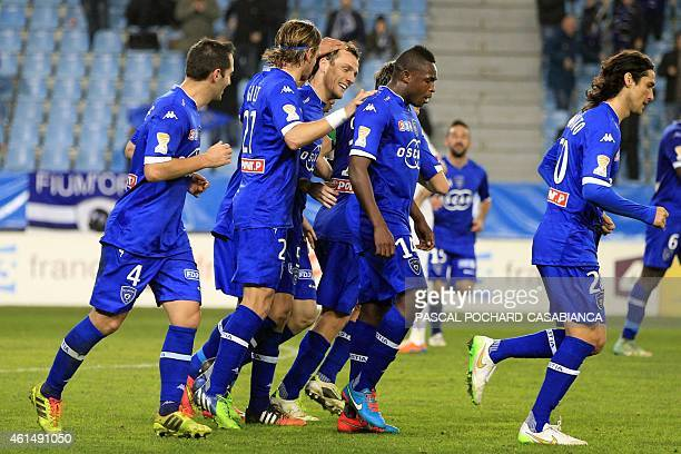 Bastia's French defender Sebastien Squillaci celebrates with tammates after scoring a goal during the French Ligue Cup football match between Bastia...
