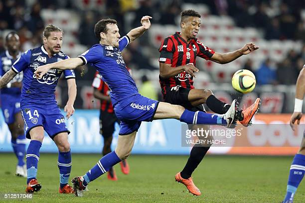 Bastia's French defender Sebastien Squillaci vies with Nice's French forward Alassane Plea during the French L1 football match Nice vs Bastia on...