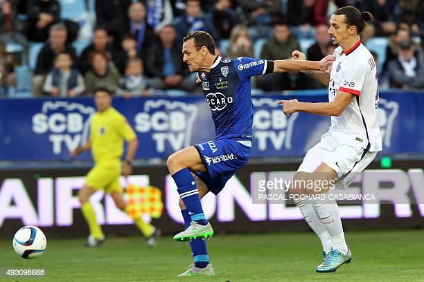 Bastia's French defender Sebastien Squillaci vies with Paris SaintGermain's Swedish forward Zlatan Ibrahimovic during the L1 football match Bastia...