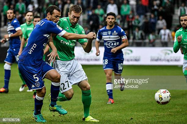 Bastia's French defender Sebastien Squillaci vies with SaintEtienne's Slovenian forward Robert Beric during the French L1 football match AS...