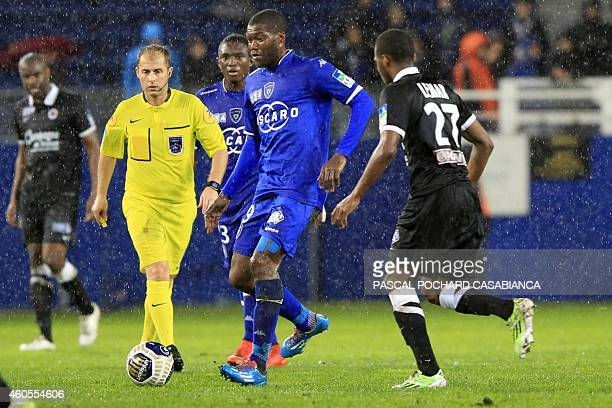 Bastia's French forward Djibril Cisse vies with Caen's French midfielder Thomas Lemar during the French League Cup football match Bastia vs Caen on...