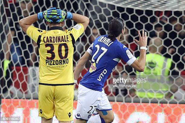 Bastia's French forward Enzo Crivelli celebrates after scoring a goal next to Nice's French goalkeeoer Yoan Cardinale during the French L1 football...