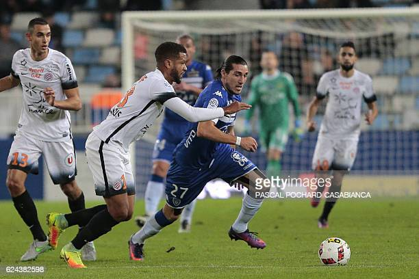 Bastia's French forward Enzo Crivelli vies with Montpellier's defender Nicolas Saint Ruf during the French L1 football match between Bastia and...