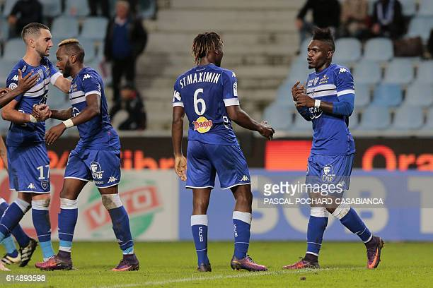 Bastia's French forward Thievy Bifouma is congratulated by teammates after scoring a goal during the French L1 football match between Bastia and...