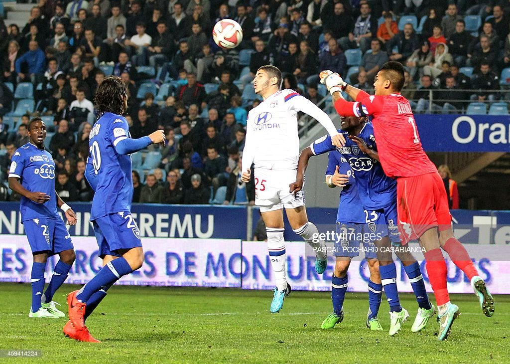 Bastia's French Goalkeeper Alphonse Areola (R) vies with Lyon's French Algerian forward Yassine Benzia (C) during the French L1 football match Bastia (SCB) against Lyon (OL) on November 22, 2014 in the Armand Cesari stadium in Bastia, French Mediterranean island of Corsica.