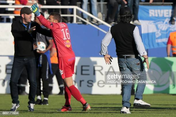 Bastia's French goalkeeper Jean Louis Leca clashes with a club's official prior to the French L1 Football match between Bastia and Lyon on April 16...