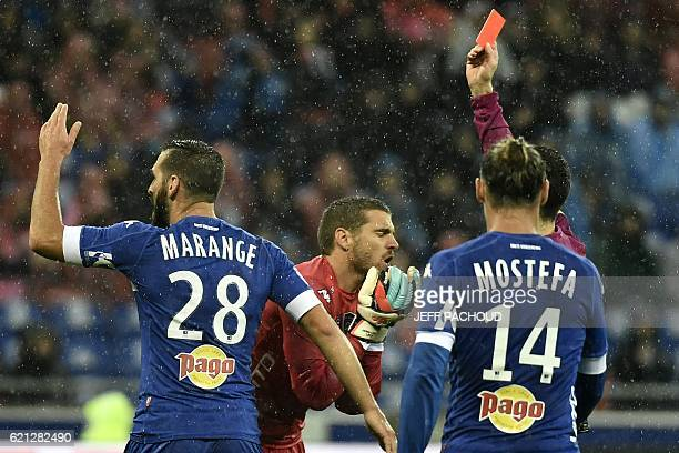 Bastia's French goalkeeper Jean Louis Leca is shown a red card during the French L1 football match Olympique Lyonnais vs Bastia on November 5 at the...