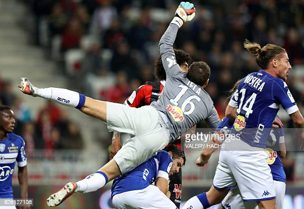 TOPSHOT Bastia's French goalkeeper Jean Louis Leca jumps during the French L1 football match between Nice and Bastia on November 27 2016 at the...