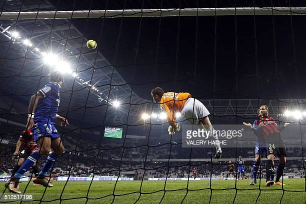 """Bastia's French goalkeeper Jean Louis Leca stops the ball during the French L1 football match Nice vs Bastia on February 26, 2016 at the """"Allianz..."""