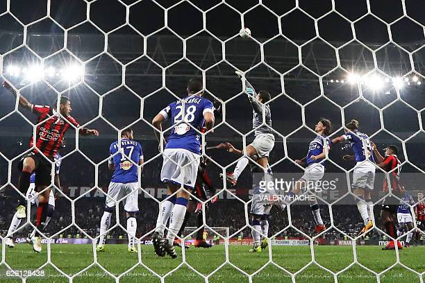 TOPSHOT Bastia's French goalkeeper Jean Louis Leca stops the ball during the French L1 football match between Nice and Bastia on November 27 2016 at...