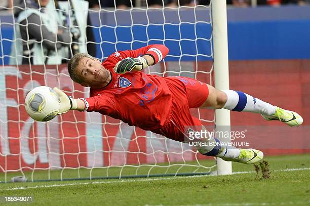 Bastia's French Goalkeeper Mickael Landreau tries to stop the ball during the French L1 football match Paris Saint Germain against Bastia on October...