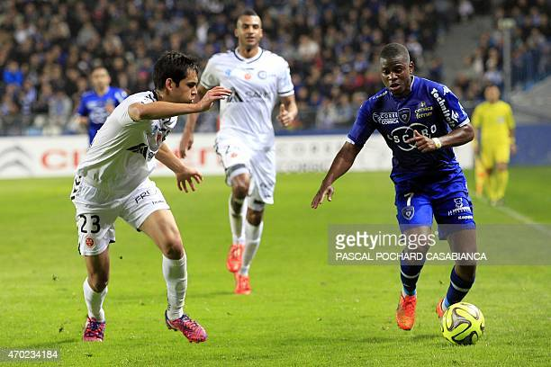 Bastia's French midfeilder Floyd Ayite vies with Reims' French Algerian defender Aissa Mandi during the French L1 football match Bastia against Reims...