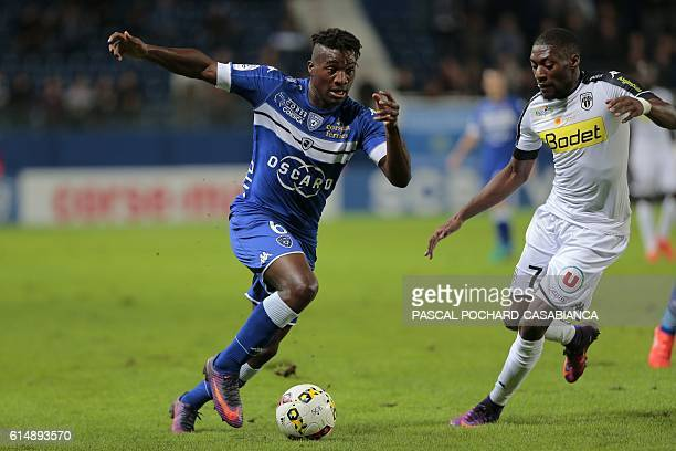 Bastia's French midfielder Allan Saint Maximin vies with Angers' Cameroun forward Karl Toko Ekambi during the French L1 football match between Bastia...