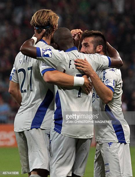 Bastia's French midfielder Floyd Ayite celebrates with teammates after scoring during the French L1 football match between Nice and Bastia on October...