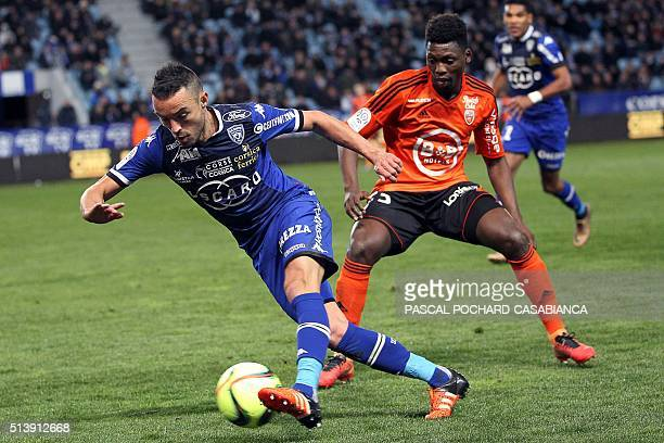 Bastia's French midfielder Gael Danic vies with Lorient's French Senegalese defender Lamine Gassama during the French L1 football match between...