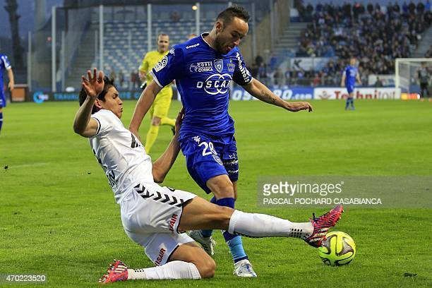 Bastia's French midfielder Gael Danic vies with Reims' French Algerian defender Aissa Mandi during the French L1 football match Bastia against Reims...