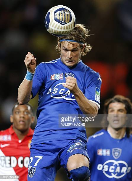 """Bastia's French midfielder Guillaume Gillet jumps during a French League Cup football match between Monaco and Bastia at the """"Louis II"""" stadium in..."""