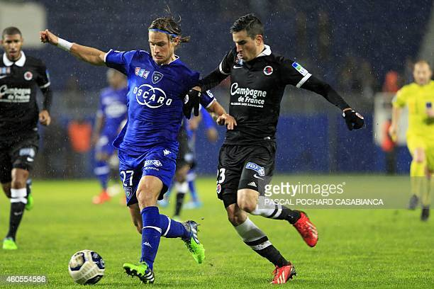 Bastia's French midfielder Guillaume Gillet vies with Caen's French defender Jean Calve during the French League Cup football match Bastia vs Caen on...