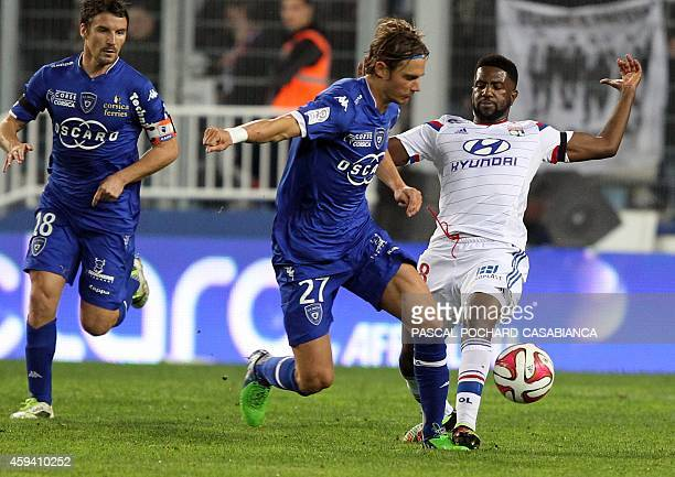 Bastia's French midfielder Guillaume Gillet vies with Lyon's French Congolese midfielder Arnold Mvuemba during the French L1 football match Bastia...