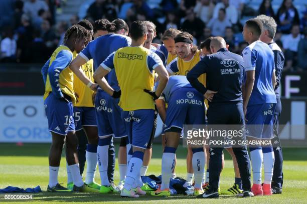 Bastia's French midfielder Yannick Cahuzac and team's captian speaks with his teammates prior to the French L1 Football match between Bastia and Lyon...