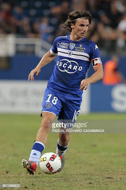 Bastia's French midfielder Yannick Cahuzac runs with the ball during to the French Ligue 1 football match between Bastia and Toulouse on September 10...