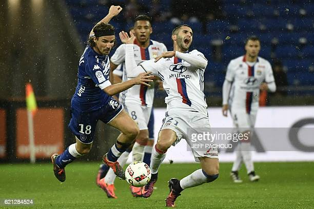 Bastia's French midfielder Yannick Cahuzac vies with Lyon's French midfielder Maxime Gonalons during the French L1 football match Olympique Lyonnais...