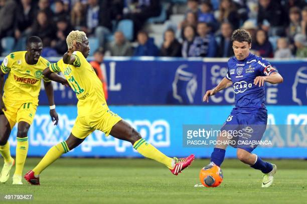 Bastia's French midfielder Yannick Cahuzac vies with Nantes' forward Ismael Bangoura during the French L1 football match Bastia against Nantes on May...