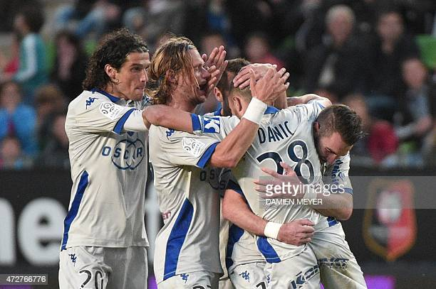 Bastia's French striker Gael Danic celebrates with teammates after scoring during the French L1 football match Rennes against Bastia on May 9 2015 at...