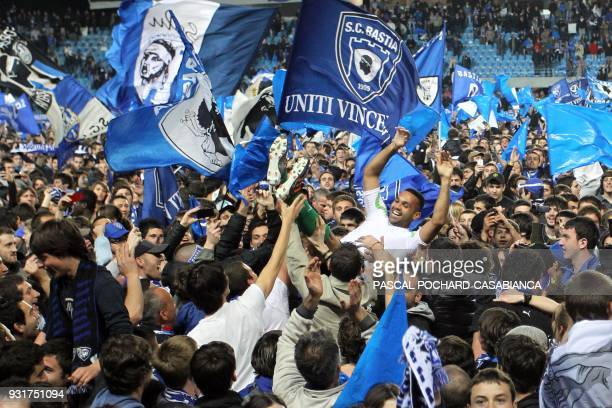 Bastia's goalkeeper Magno Macedo Novaes celebrates with supporters after winning the French L2 football match Bastia vs Chateauroux on April 23 2012...