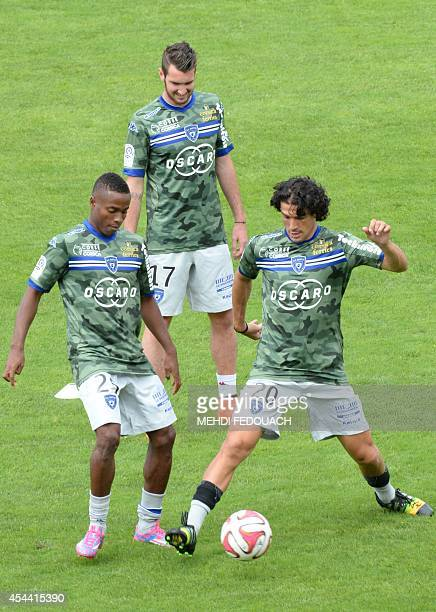 Bastia's Guinean forward Francois Kamano Bastia's French defender Mathieu Peybernes and Bastia's French defender FrançoisJoseph Modesto warm up prior...