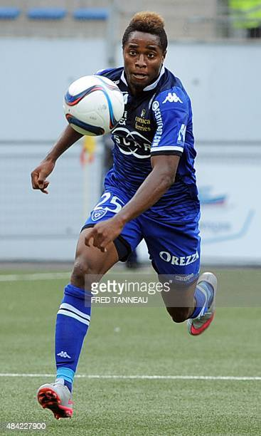 Bastia's Guinean forward Francois Kamano runs for the ball during the French L1 football match Lorient vs Bastia on August 16 2015 at the Moustoir...