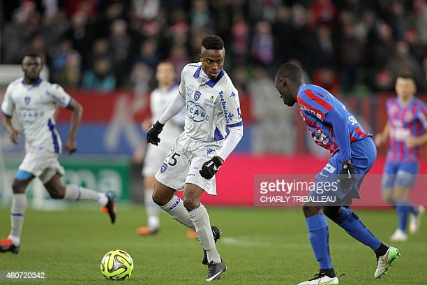 Bastia's Guinean forward Francois Kamano vies for the ball with Caen's French defender Dennis Appiah during the French L1 football match Caen vs...