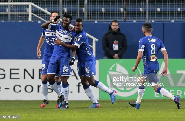 Bastia's Guinean forward Sadio Diallo is congratulated by teammates after scoring a goal during the L1 football match Bastia against Monaco on...