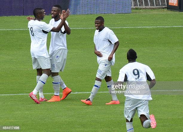 Bastia's Ivorian forward Junior Tallo celebrates with teammates after scoring a goal during the French L1 footbal match Bordeaux vs Bastia on August...