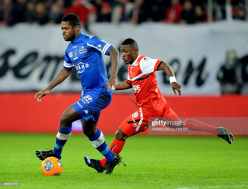 Bastia's Ivorian midfielder Romaric N Dri Koffi (L) vies with Valenciennes's Majeed Waris during the French L1 football match Valenciennes vs Bastia at Stade du Hainaut in Valenciennes on January 11, 2014.