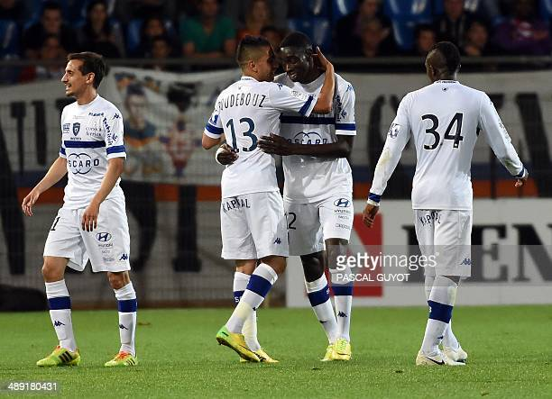 Bastia's midfielder Sambou Yatabare reacts after scoring a goal during the French L1 football match Montpellier vs Bastia at Mosson stadium in...