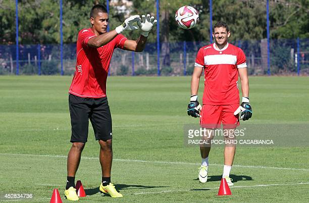 Bastia's newly recruited French goalkeeper Alphonse Areola prepares to catch a ball under the eyes of French goalkeeper Jean Louis Leca as they take...