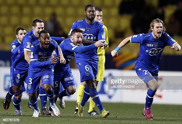 Bastia's players celebrate after winning in penalty shootouts the French League Cup semifinal football match between Monaco and Bastia at the Louis...