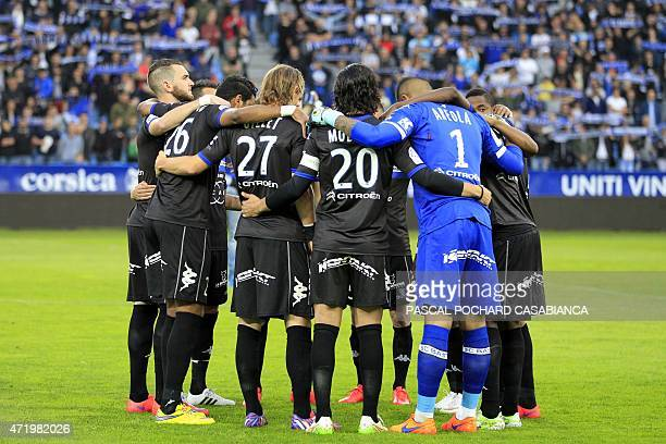 Bastia's players gather to pay homage to victims of the match of May 5 1992 during which 18 persons died before the French L1 football match between...