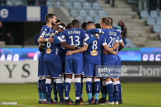 Bastia's players observe a minute of silence for the players of the Brazilian Chapecoense football team killed in a plane crash on November 28 2016...