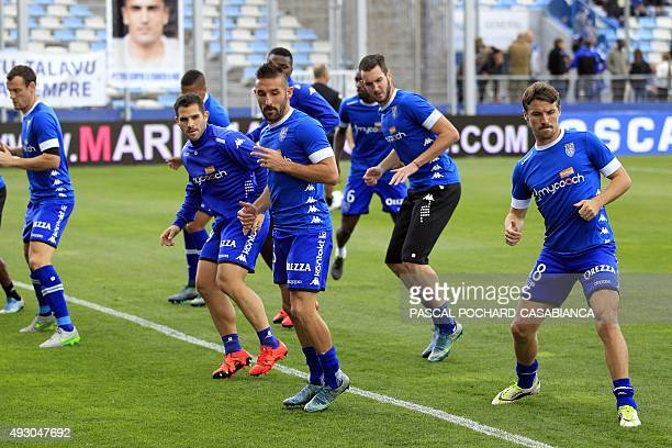 Bastia's team warms up before the L1 football match Bastia against Paris on October 17 at the Armand Cesari stadium in Bastia on the French...