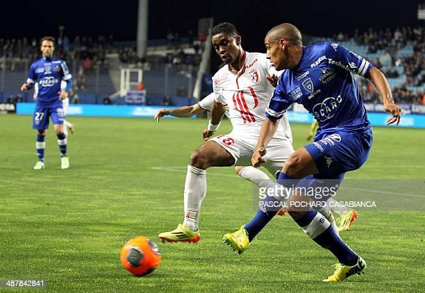Bastia's Tunisian midfielder Wahbi Khazri vies with Lille's French defender Franck Beria during the French L1 football match Sporting Club Bastia...