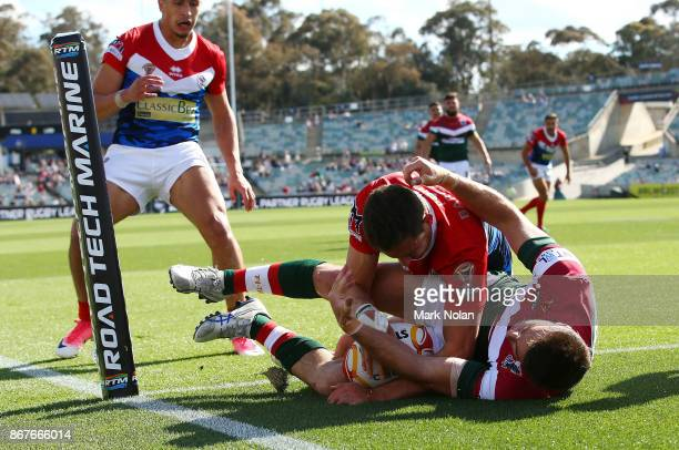 Bastien Ader of France scores a try during the 2017 Rugby League World Cup match between France and Lebanon at Canberra Stadium on October 29 2017 in...