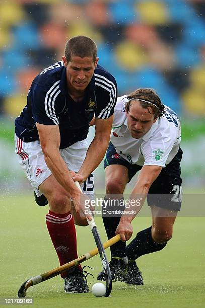 Bastien Dierckens of France is challenged by Michael Darling of Ireland during the Men´s EuroHockey Championships 2011 Pool B match between France...