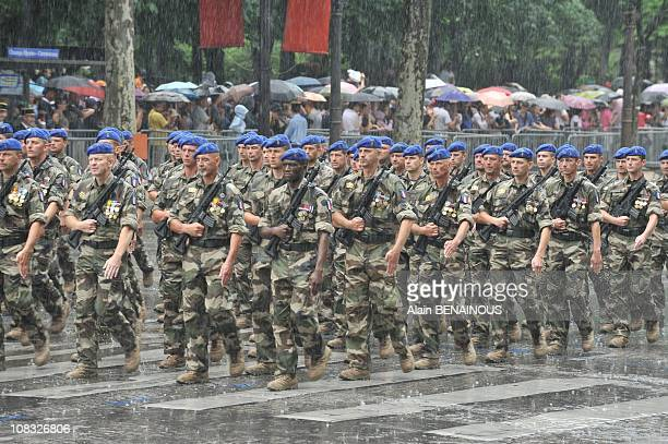 Bastille Day annual military parade in driving rain in Paris France on July 14th 2010
