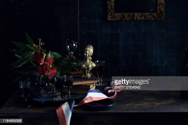 bastille day celebration, glasses with red wine, old master painting and a red white and blue ribbon, colours of the french flag - bastille day stock pictures, royalty-free photos & images